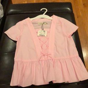 Girl's Zara soft pink top.